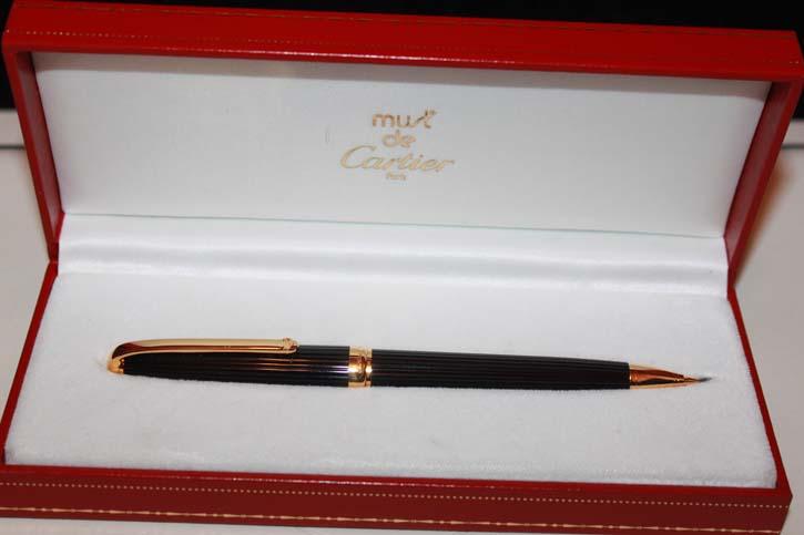 Cartier Cougar Bleistift in Schwarz und Gold in OVP