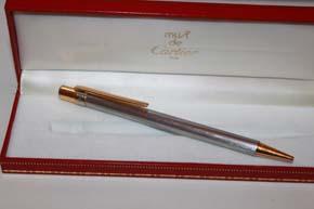 Cartier Stylo Santos Kugelschreiber in silbern satiniert mit Schrauben